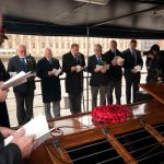 Congregation sing on board Havengore on Armistice Day