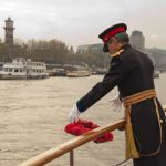 Maj Gen Keith Cima casts wreath onto the waters of the Thames on Armistice Day