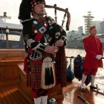 Chic Mackie plays the pipes on board for Armistice Day