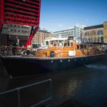 Havengore leaves her berth at St Katharine Docks and enters lock