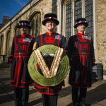 Yeoman Guard collect  Wreath from the Chapel Royal St Peter ad Vincula, where it has been on display at the Tower of London